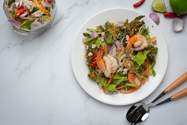 Spicy crispy morning glory salad with shrimp, spicy fresh shrimp, thai food.