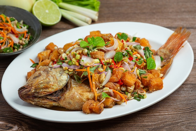Spicy fried tubtim fish salad, spicy, thai food.