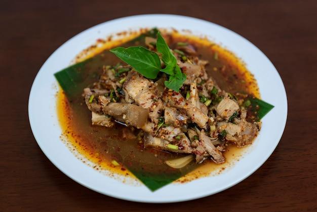 Spicy grilled pork salad, nam tok moo, thai food