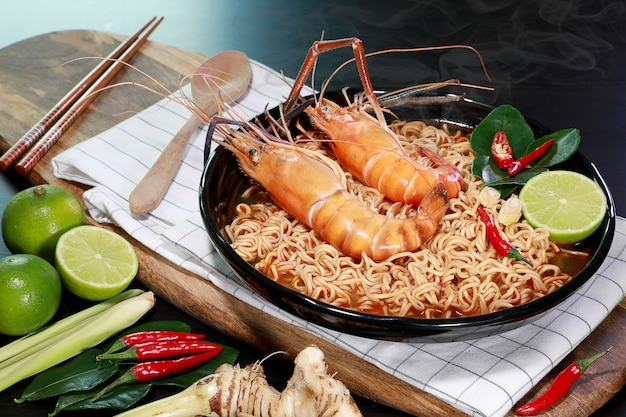 Spicy instant noodles soup with rivers shrimp on top, tom yum kung name in thailand foods style.