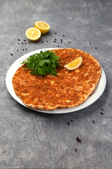Spicy lahmajun with lemon and herbs