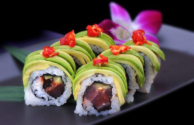 Spicy maki sushi roll with avocado