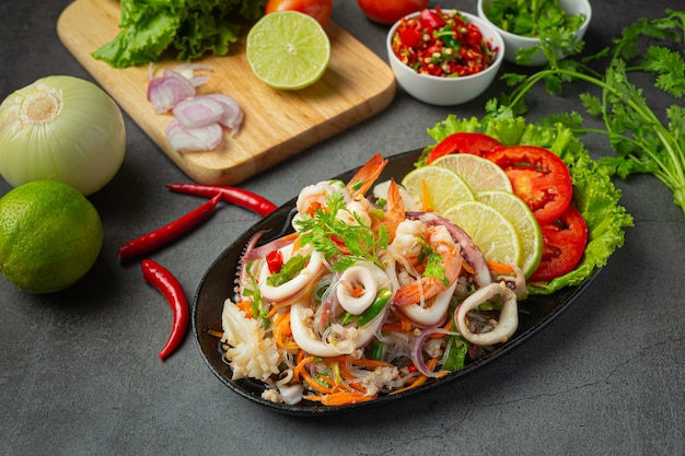 Spicy mixed seafood salad with thai food ingredients.