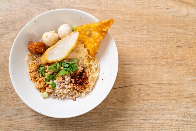Spicy noodles with fish ball and minced pork (tom yum noodles), asian food style