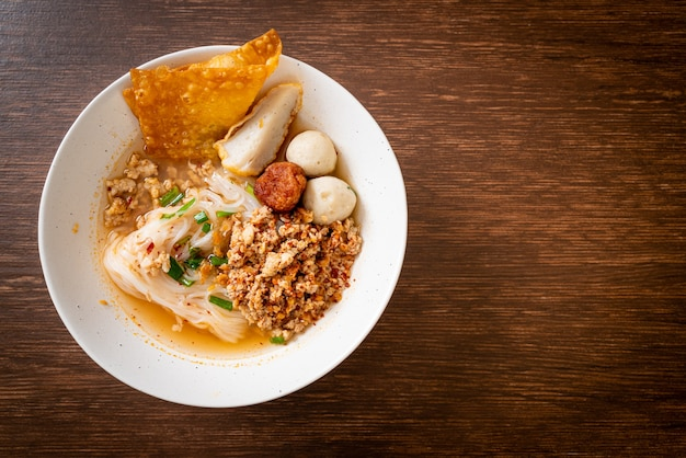 Spicy noodles with fish ball and minced pork (tom yum noodles) - asian food style