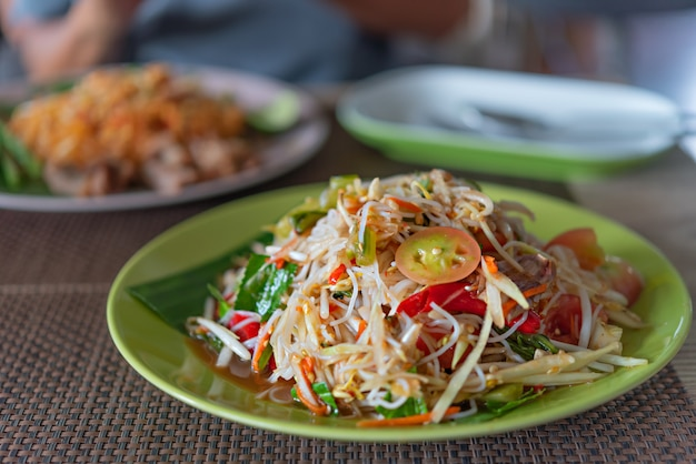 Spicy papaya salad with rice vermicelli