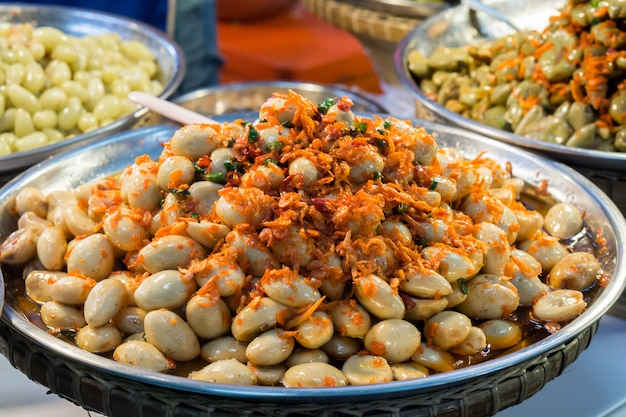 Spicy pickled madan with chili. garcinia or madan preserves for snack.
