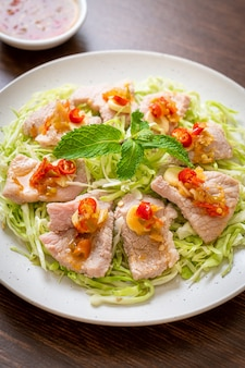 Spicy pork salad or boiled pork with lime garlic and chili sauce