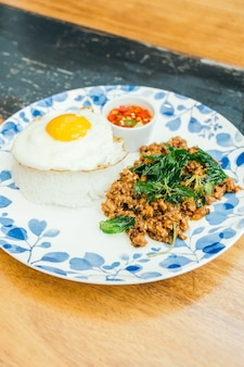 Spicy pork with basil leaf and rice