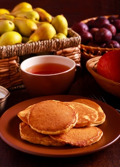 Spicy pumpkin pancakes and cup of tea