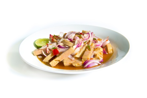 Spicy salad with fermented pork sausage and chili paste. thai food on dish isolated on white background