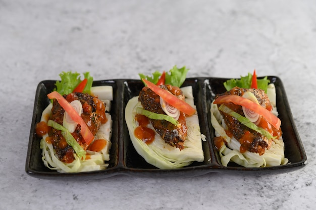 Spicy sardines in ceramic tray