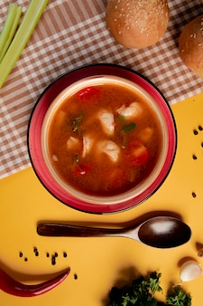 Spicy soup with tomatoes and herbs