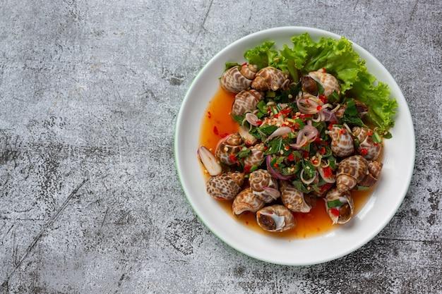 Spicy spotted babylon salad on dark background