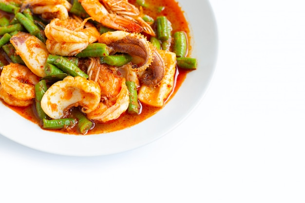Spicy stir fried seafood and yard long bean with red curry paste. thai food