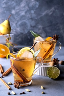 Spicy warm beverage. seasonal mulled drink. christmas hot white mulled wine in glass with orange