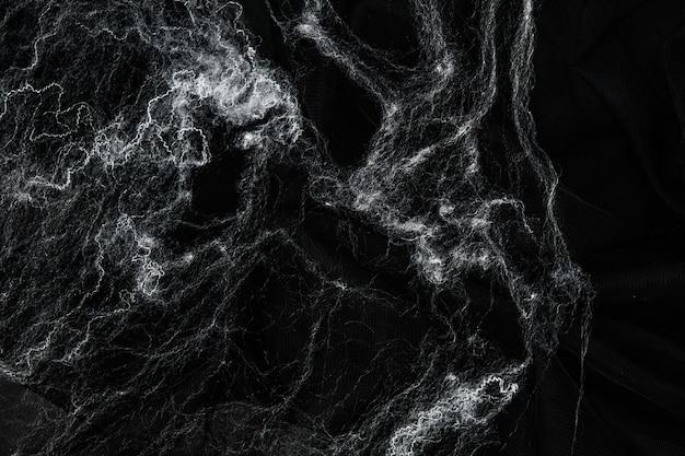 Паутина на черном фоне. концепция хэллоуина.
