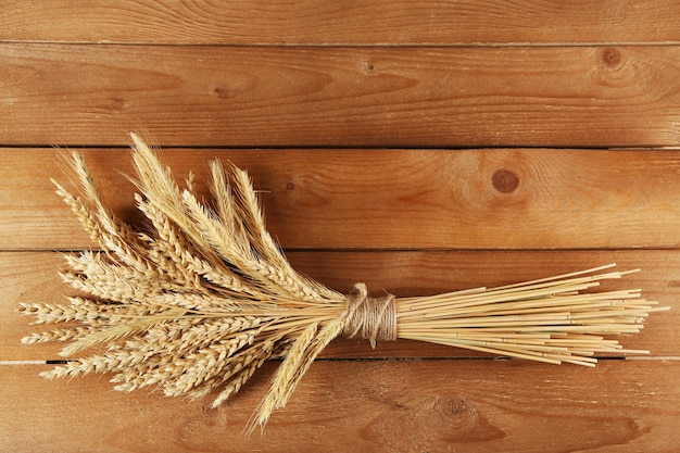 Spikelets of wheat on wooden