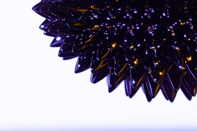Spiky purple ferromagnetic liquid metal with copy space