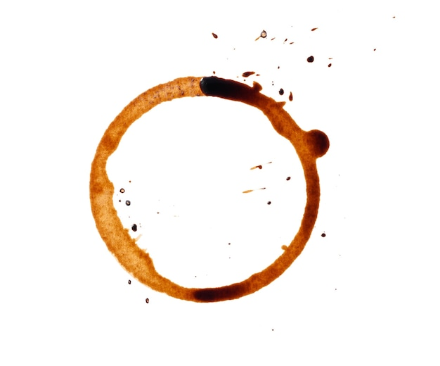 Spilled black coffee on a white background. round blotprint from the bottom of the cup with fine splashes, top view