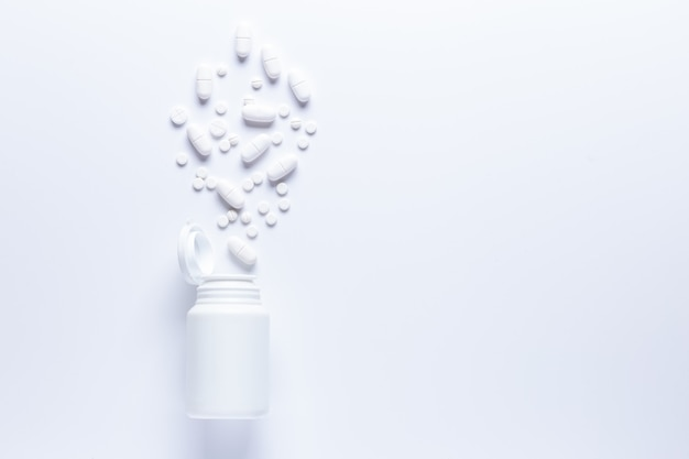 Spilled pill bottle with tablets