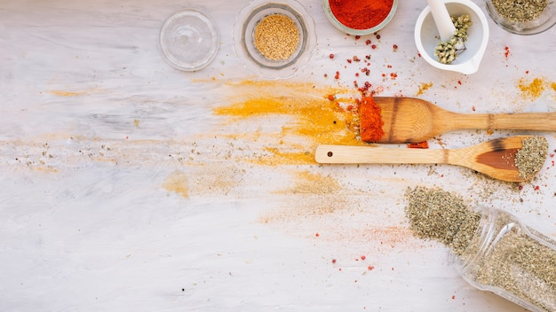 Spilled spices near spatulas