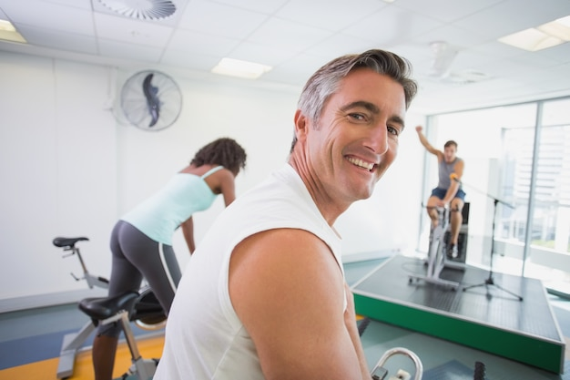 Spin class working out with motivational instructor