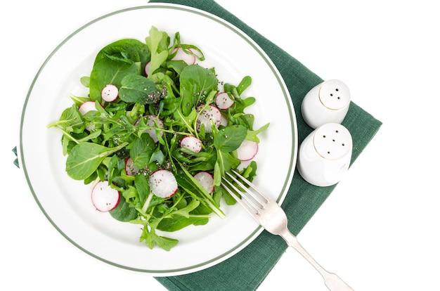 Spinach, arugula, radish and chia seeds. studio photo
