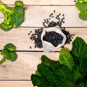 Spinach and black beans on a wooden table