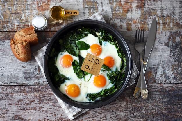 Spinach eggs with cannabis oil.