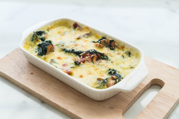 Spinach lasagna in white plate