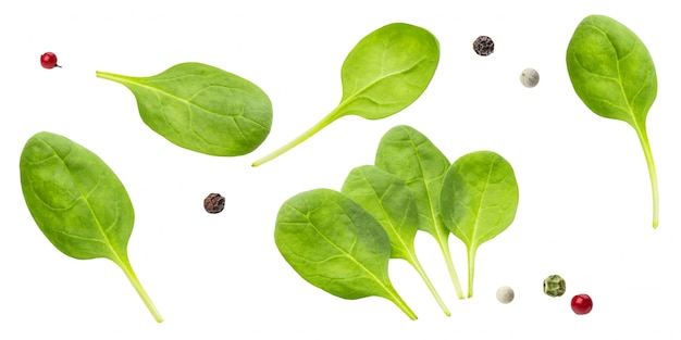 Spinach leaves and peppercorns