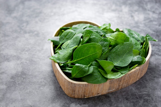 Spinach leaves in wooden box