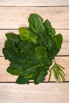Spinach on a wooden table