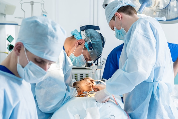 Spinal surgery. group of surgeons in operating room with surgery equipment. laminectomy