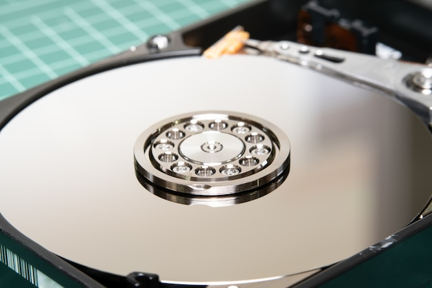 Spindle with plate and actuator arm opened hard disk drive hdd.
