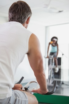Spinning instructor motivating her class
