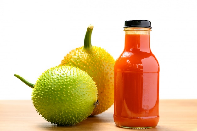Spiny bitter gourd juice in bottle with fruits