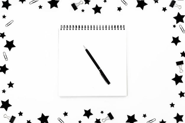 Spiral empty white notepad on festive christmas background.