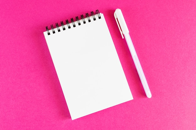 Spiral notepad on bright pink