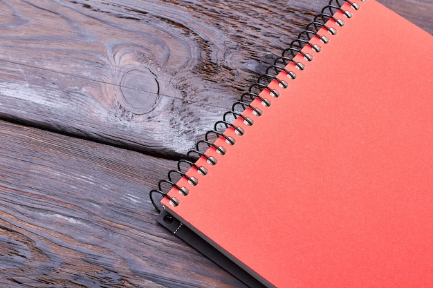 Spiral notepad on wooden backdrop. top view of a notepad. write your thoughts and ideas.