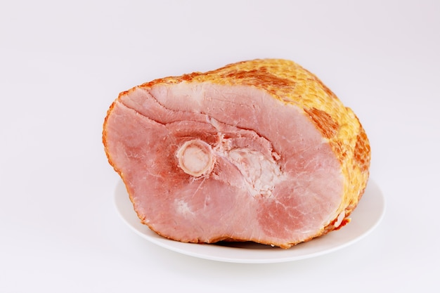 Spiral sliced hickory smoked ham isolated on white surface