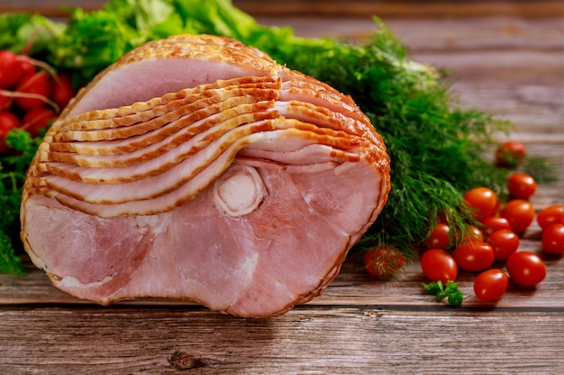 Spiral sliced hickory smoked ham with fresh herb and tomatoes