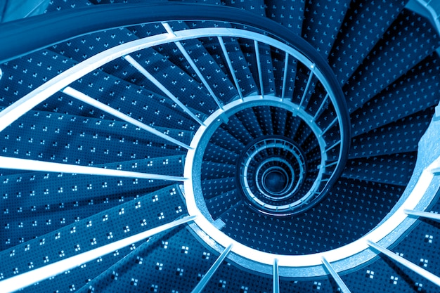 Spiral staircase on toning in classic blue color