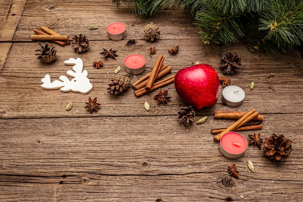Spirit christmas  tree, apple, candles, spices, deer, cones. nature decorations, vintage wooden boards
