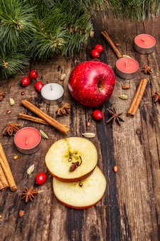 Spirit christmas  tree, fresh apple, cinnamon,  candles, cardamom, star anise. nature decorations, vintage wooden boards