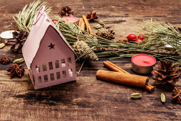 Spirit christmas  tree, light house,  candles, spices, deer, cones. nature decorations, vintage wooden boards
