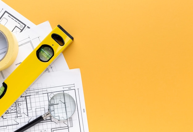 Spirit level and blue prints with copy space