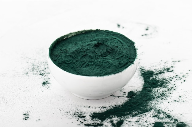 Spirulina powder in a spoon