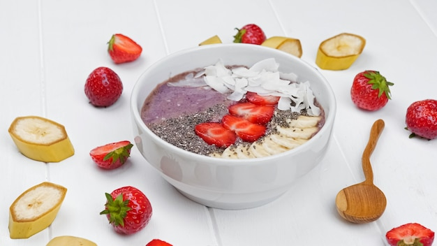 Spirulina seaweed smoothie with chia berries and fruits healthy food flat lay